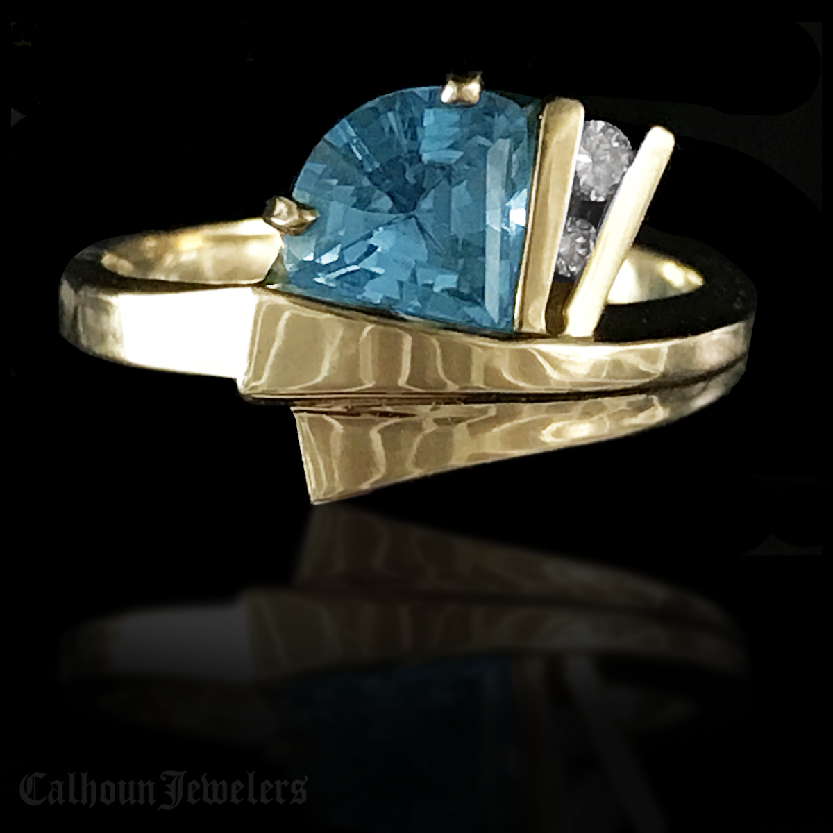 Fancy Cut Blue Topaz and Diamond Ring